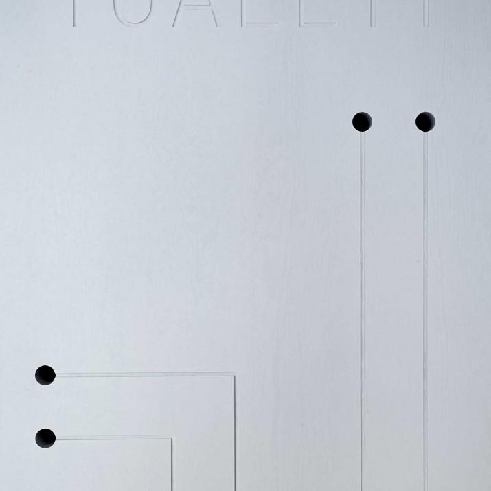 Bistro Proti Proudu Praha Karlín - detail dveří na toalety.